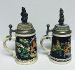 2 Hamms Bear lidded steins with Bears on top - Left View